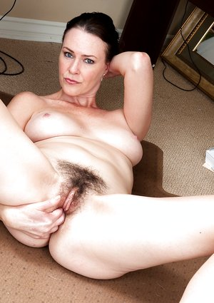 Veronica Snow fingers her hairy pussy at work