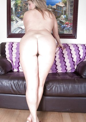 Alicia Silver strips naked on her leather sofa