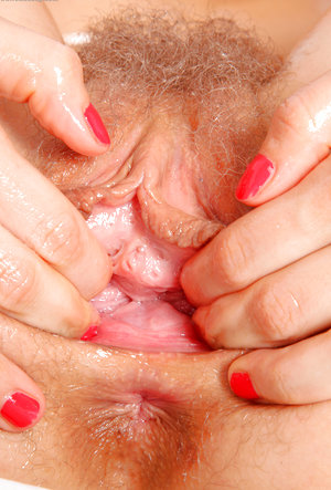 Beatrice Spreads Open her Hairy Wet Vagina