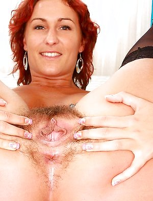 Celine fucks her hairy muff with a string of balls and cums