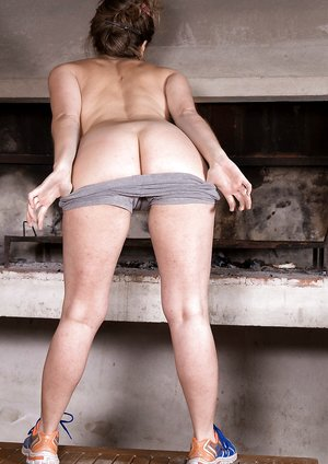 Guadalupe strips naked to play by her oven