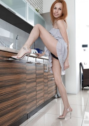 Liliya wets down body after stripping in kitchen
