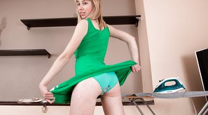 Natinella strips off her sexy green dress