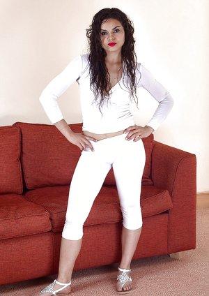 Sierra models her white jumpsuit as she gets naked