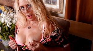 Hairy American mature lady playing alone