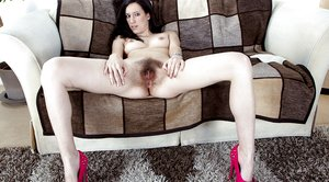 Hairy Brunette Sadie Matthews playing on the sofa