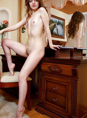 Klarissa flaunts her pink nipples and unshaven pussy on the chair.